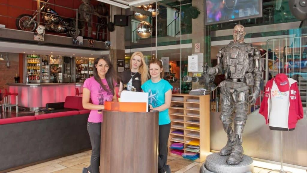 teenagers taking a photo with Terminator robot at planet hollywood