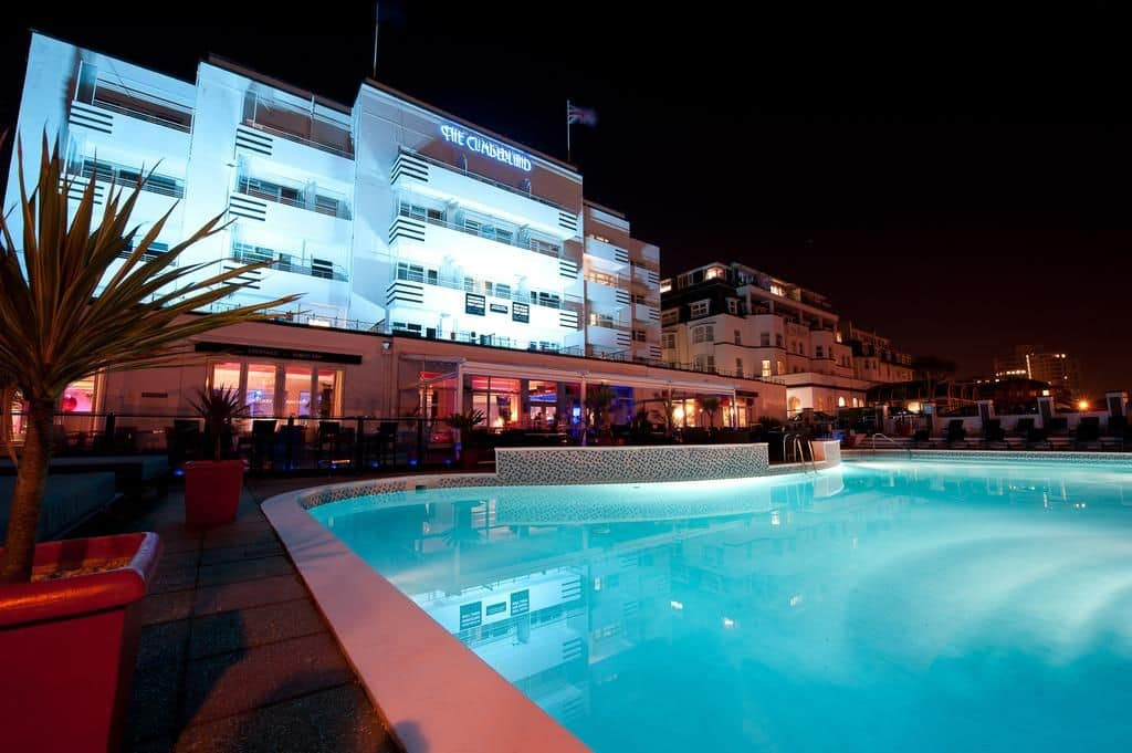 At night the stunning art deco The Cumberland including swimming pool