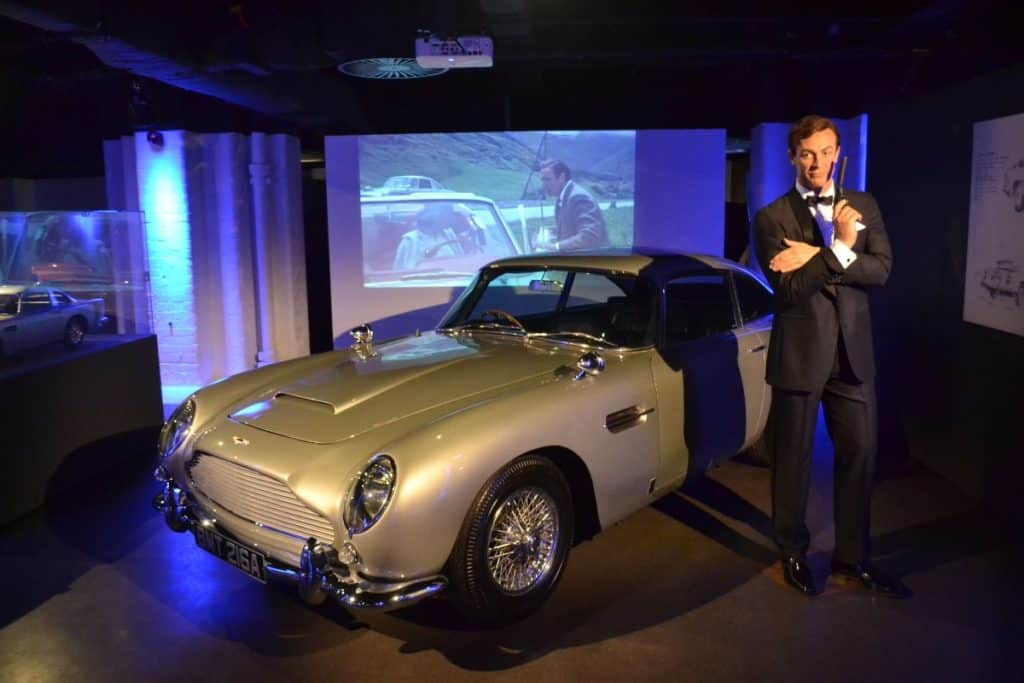 wax figure of james bond and his car at kid-friendly london film museum