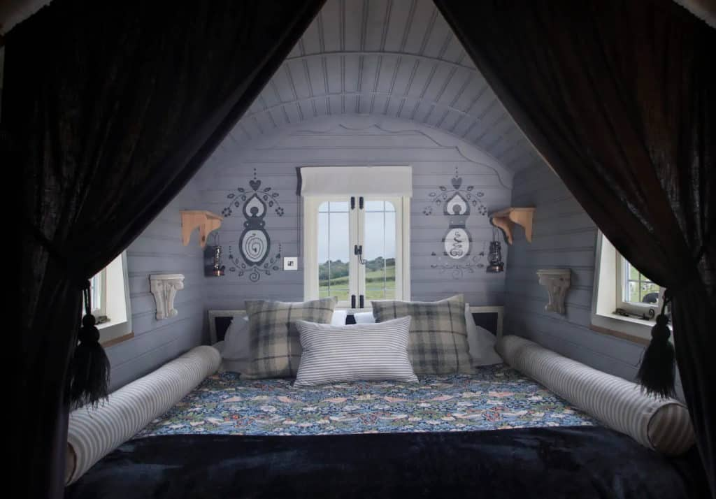 Lose yourself in the luxurious kingsize bed that fills the gypsy wagon from wall-to-wall